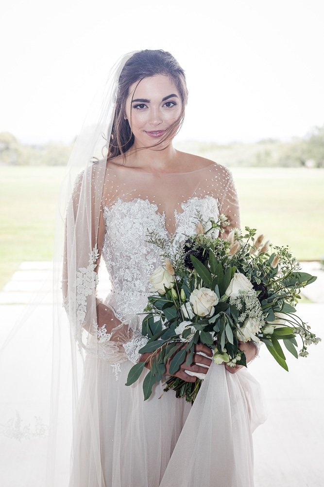 A bride at The Lodge at Harvey 5 Wedding and Event Venue in Gatesville Texas